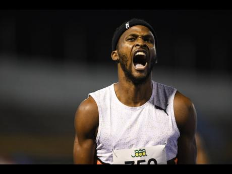 Jaheel Hyde celebrates his win in the men's 400m hurdles final at the National Senior Championships at the National Stadium on Friday, June 25.