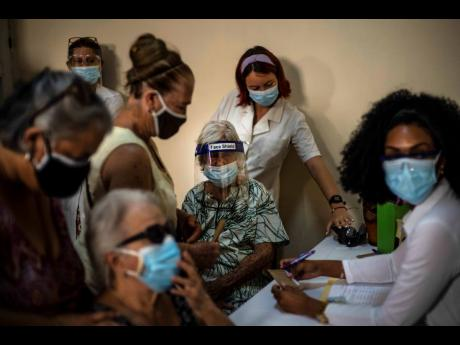 People sign up for a dose of the Cuban Abdala COVID-19 vaccine in Havana, Cuba.