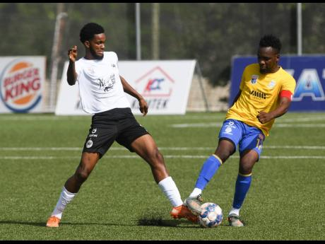 Harbour View's Ajeanie Talbott comes together with Cavalier's Shaniel Thomas during a Jamaica Premier League game at the UWI/JFF Captain Horace Burrell Centre of Excellence on Monday, July 5.