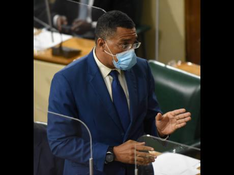 Prime Minister Andrew Holness addresses lawmakers in the House of Representatives on Tuesday.