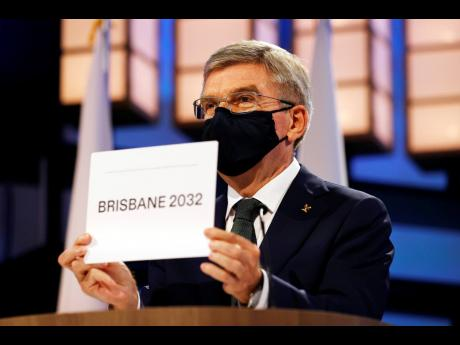 President of the International Olympic Committee (IOC), Thomas Bach, announces Brisbane as the 2032 Summer Olympics host city during the 138th IOC Session at Hotel Okura in Tokyo, on Wednesday, July 21, 2021.