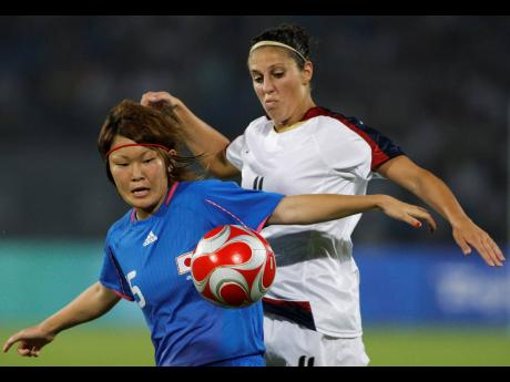 In this August 18, 2008 file photo, Carli Loyd (right) of the United States vies for the ball with Mizuho Sakaguchi of Japan, during the Beijing 2008 Olympics women semi-finals soccer match in Beijing. Older Olympians will be proving that age is just a num