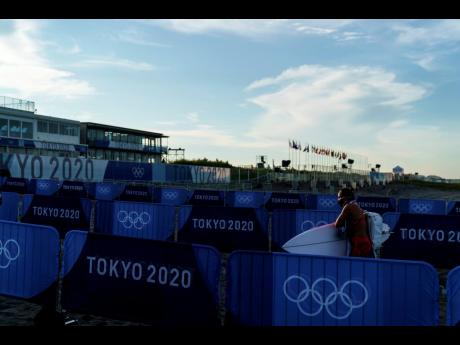 Surfer Carissa Moore, of the United States, comes out of the water after a practice session at Tsurigasaki beach at the Tokyo 2020 Olympics in Ichinomiya, Japan, yesterday.