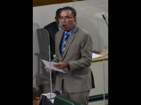 Minister of Science and Technology Daryl Vaz pilots a resolution in Parliament on Tuesday.