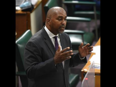Opposition Spokesman on Finance Julian Robinson cautions the Government in Parliament on Tuesday.