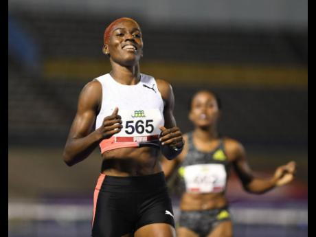 Janieve Russell wins the women's 400m hurdles final at the National Senior Championships at the National Stadium in St Andrew on Friday, June 25.