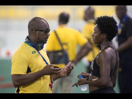 Coach Okeile Stewart (left) and 400m hurdler Rushell Clayton in discussion during a training session at the Qatar Sports Club ahead of the World Athletics Championships in Doha, Qatar, in September 2019.