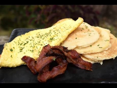 Omelette with a a stack of fluffy pancakes and a side of bacon is available all day.
