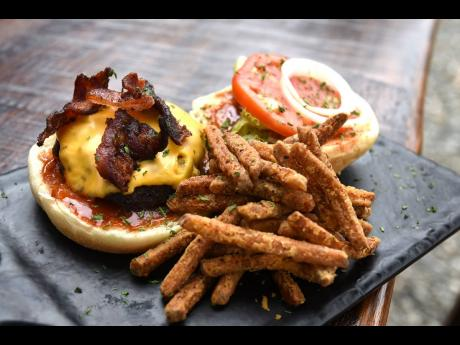 The Blue Brews Bistro's famous Classic Burger, a member of the Holy Cow Burger Menu.