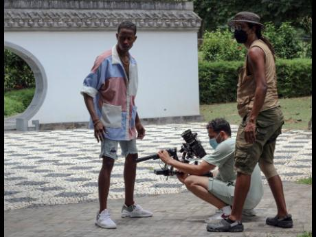 Red Bull Dance Your Style champion Jevaughn 'Pancho' Williams takes direction from the crew as film director Yoram Savion (centre) and second camera assistant Jik-Reuben Pringle plan the next move.