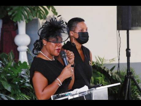 Dr Kim Robb Bryan (left) and her sister, Natalie Robb-Cato, pay tribute to their late father, noted attorney-at-law Nathan Robb.