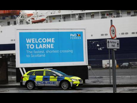 AP  Police patrol the port of Larne, Northern Ireland, in February.