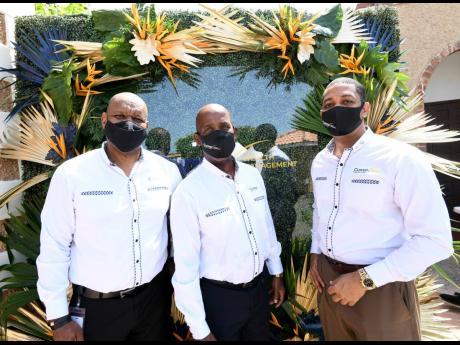 From left: Ian McNaughton, chief executive officer, Cumax Wealth Management; Lambert Johnson, chairman, Cumax Wealth Management; and Robin Levy, group chief executive officer, Jamaica Co-operative Credit Union League.
