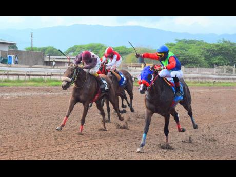 She's A Wonder (right), ridden by Reyan Lewis, wins the Portmore Cup at Caymanas Park on Saturday, May 1.