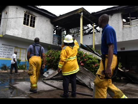 Fire completely destroyed a building that housed the administrative offices at the Hydel Group of Schools along Mandela Highway in St Catherine yesterday morning, resulting in millions of dollars in damages.