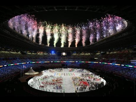Fireworks are set off on the roof of the Olympic Stadium after the parade of teams during the opening ceremony of the Olympic Games in Tokyo, Japan on Friday morning.