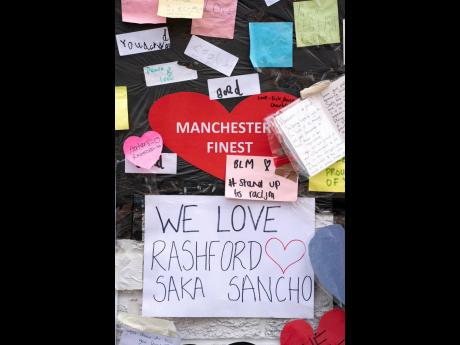 A view of the messages of support left on a mural of Manchester United striker and England player Marcus Rashford, on the wall of the Coffee House Café on Copson Street in Withington, Manchester, England.