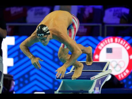 In this June 19, 2021, file photo, Michael Andrew participates in the men's 50 freestyle during wave 2 of the United States. Olympic Swim Trials in Omaha, Nebraska. A debate is fomenting between former gold medallist Maya DiRado and some American swimmer
