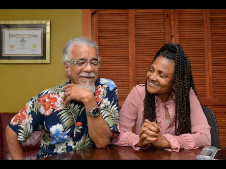 Tommy Cowan (left), and wife, Carlene Davis, recalled Nelson Mandela's historic 24-hour visit to Jamaica.