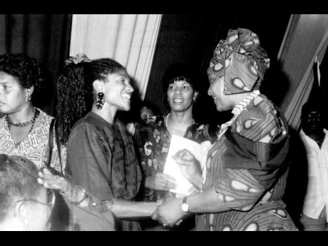 Singer Carlene Davis (left), one of the most powerful local singers in the fight for liberty for black South Africans, was singled out for special meeting by Winnie Mandela (right) on her visit to Jamaica with her husband Nelson Mandela. Davis's two song