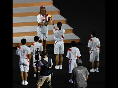The torch relay at the opening ceremony at the Tokyo 2021 Olympics held at the Olympic Stadium in Tokyo, Japan on Friday, July 23, 2021.