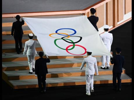 The Olympic flag raising ceremony during the opening ceremony for the Tokyo 2021 Olympics held at the Olympic Stadium in Tokyo, Japan on Friday, July 23, 2021.