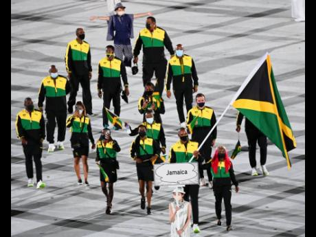 Sprinter Shelly-Ann Fraser-Pryce and boxer Ricardo 'Big 12' Brown led Team Jamaica as its flag-bearers at the opening ceremony of the Olympic Games at the National Stadium in Tokyo, Japan.