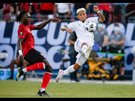 Trinidad defender Aubrey David (left) and El Salvador midfielder Amando Moreno vie for the ball during a 2021 Concacaf Gold Cup Group A match on Wednesday, July 14 in Frisco, Texas. El Salvador won 2-0.