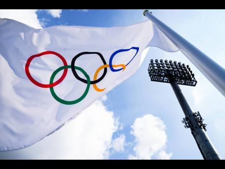 A flag bearing the Olympic Rings.
