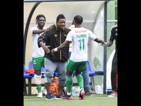 Vere Untied's  Romaine Plummer (back to camera) celebrates with coach Donovan Duckie after scoring the winning goal during their Jamaica Premier League football match, at the Captain Horace Burrell Centre of Excellence at UWI, Mona, on Saturday, August 24.