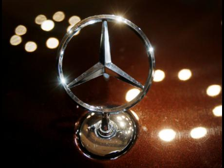 The logo of a Mercedes car is photographed at Daimler AG in Stuttgart, Germany.