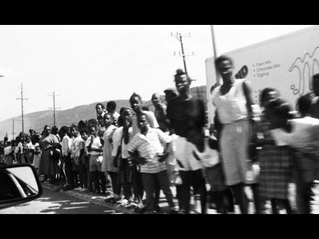 Persons lined the streets to get a glimpse of Nelson and Winnie Mandela.