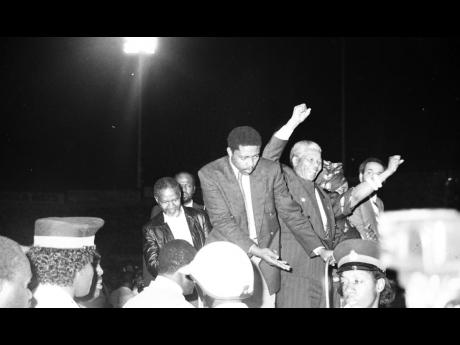 Nelson and Winnie Mandela acknowledging the crowd at the National Stadium.