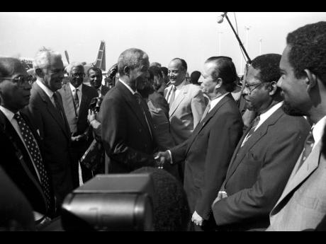 Nelson Mandela greeting Leader of Opposition Edward Seaga.