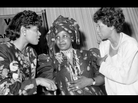 Winnie Mandela at the centre of things as Ministry of Labour, Welfare and Sports, Portia Simpson (left) and Advisor on Women's Affairs, Beverley Manley exchange thoughts with her during a luncheon held in their honour at the Pegasus Hotel.
