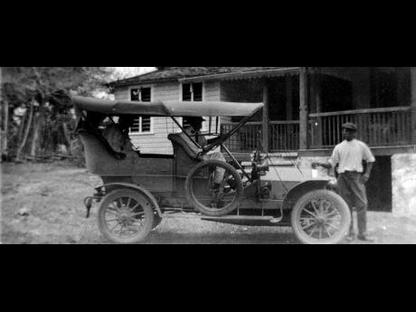 English architect Jack Winder's car is parked proudly in front of the house. Winder came to the island before World War I and left at the end of the war around 1918.