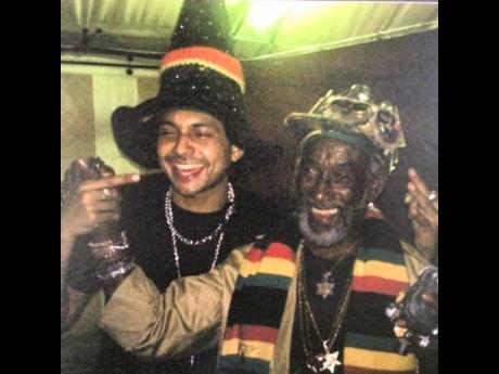 Sean Paul (left) and legendary record producer Lee 'Scratch' Perry. Sean Paul recounted the story of how Scratch Perry gave him a crystal in 2005 that he now wears as a pendant.