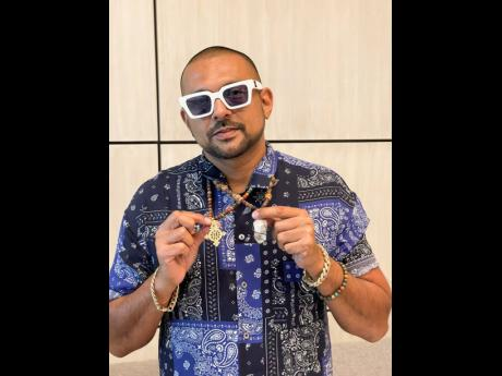 When we met up with Sean Paul, he was wearing an Ethiopian cross gifted to him by the mother of a friend of his and a crystal given to him by Lee 'Scratch' Perry.