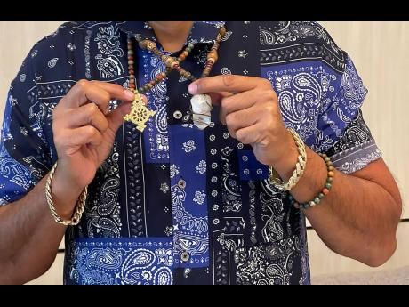 Both the Ethiopian cross (left) and crystal hold sentimental value for Sean Paul.