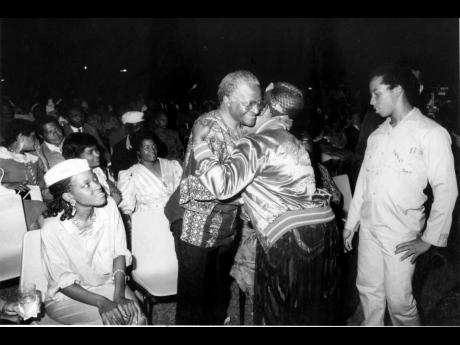 Rita Marley gives a warm welcome to the South African cleric Desmond Tutu when she met him at the cultural concert held in his honour in 1986. At right is her son Ziggy Marley, and, at left, Mpho, the daughter of Tutu.