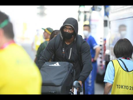 Sprinter Yohan Blake carries his luggage among the contingent of Jamaican athletes and coaches upon their arrival at the Olympic Village on Friday, July 23, 2021.