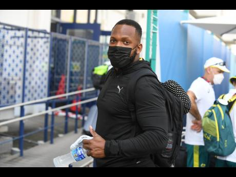 Discus thrower Traves Smikle looks on from among the contingent of Jamaican athletes and coaches as they arrive at the Olympic Village on Friday, July 23, 2021.
