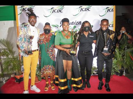 Stacious, winner of the 2021 Festival Song Competition is surrounded by (from left), Tamo J, third-place finisher;  Minister of Culture, Gender, Entertainment and Sport Olivia 'Babsy' Grange; Digicel Brand Marketing Manager Reshima Kelly-Williams and s