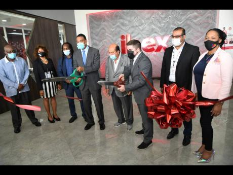 Prime Minister Andrew Holness (fourth left) and Jaime Vergara (third right), country manager of IBEX, cutting the ribbon at the official opening of IBEX building and G-Tech Park by Portmore Holdings Limited in Portmore, St Catherine, last Friday. Others pr