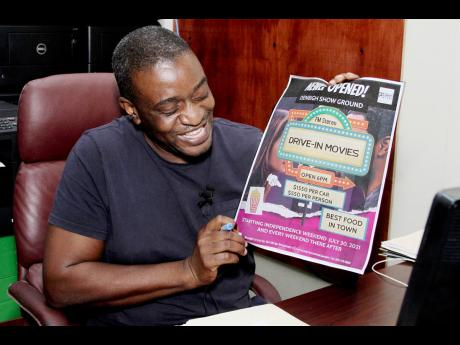 Everel Morris, chief executive officer of Net Merge, holds a flyer inviting patron to the July 30 opening of the Clarendon drive-in.