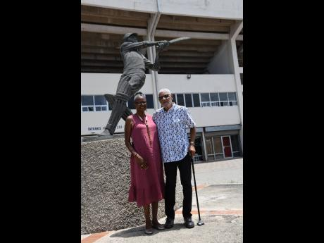 Headley George 'Dellmar' Samuels, his wife of 52  years, Carol, and the famed statue of George Headley.