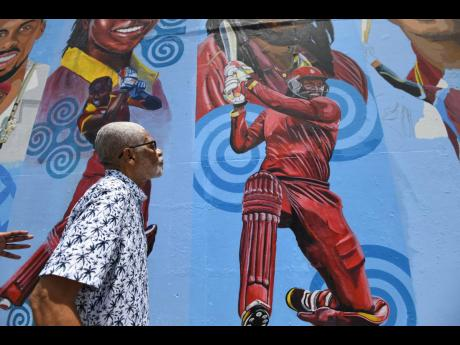 Headley George 'Dellmar' Samuels looks at a mural of one of his favourite batsmen, Chris Gayle, at the famous Sabina Park in Kingston.