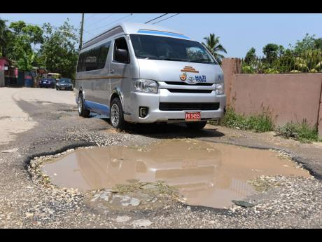 August Town Road in Bog Walk, St Catherine is badly in need of repairs.