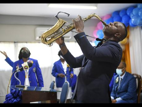 Sergeant Andre Gillespie performing a musical item at the Nurses Association of Jamaica's Nurses Week church service held at the Mary Seacole House in St Andrew on Sunday, July 18.