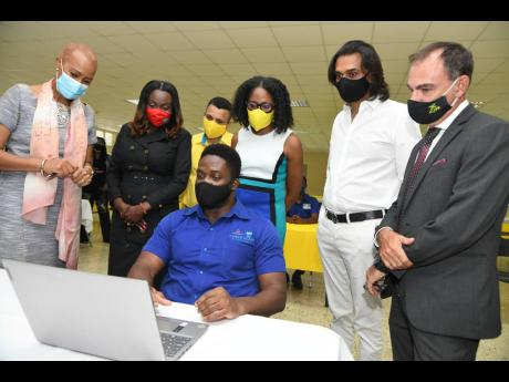 Standing (from left): Fayval Willims, minister of education, youth and information; Kay-Marie Forbes-Robotham, director, strategic partnerships research and innovation, HEART/NSTA Trust; Andrew Pairman, CEO, Anbell Group of Companies; Nadeen Matthews Blair